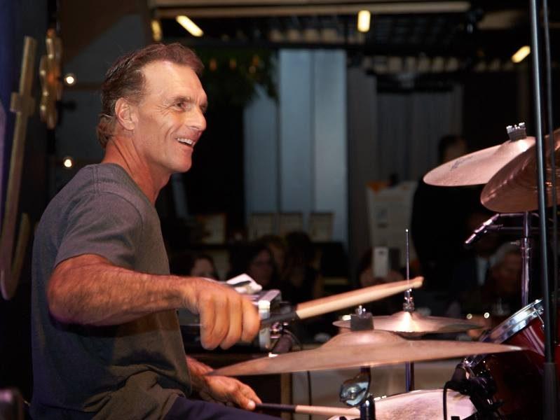 Doug Flutie plays drums.