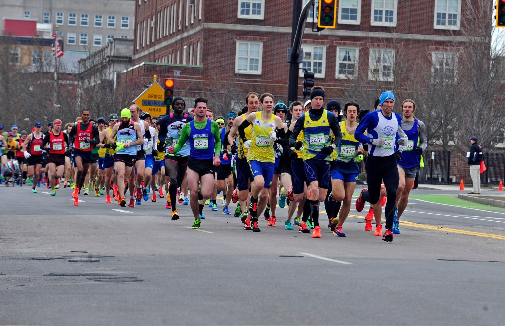 Runners competing in New Bedford Half Marathon on Pleasant Street.