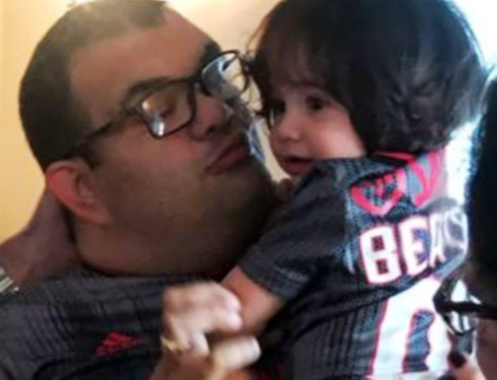 Carlos Barreira holds niece.