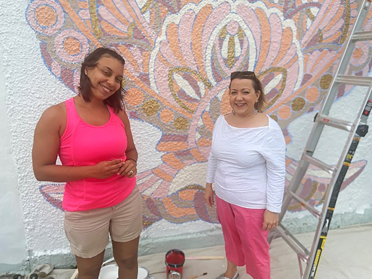 New Bedford Creative Strategist Margo Saulnier with artist Veronica Geary, who is painting a new mural at West Beach.
