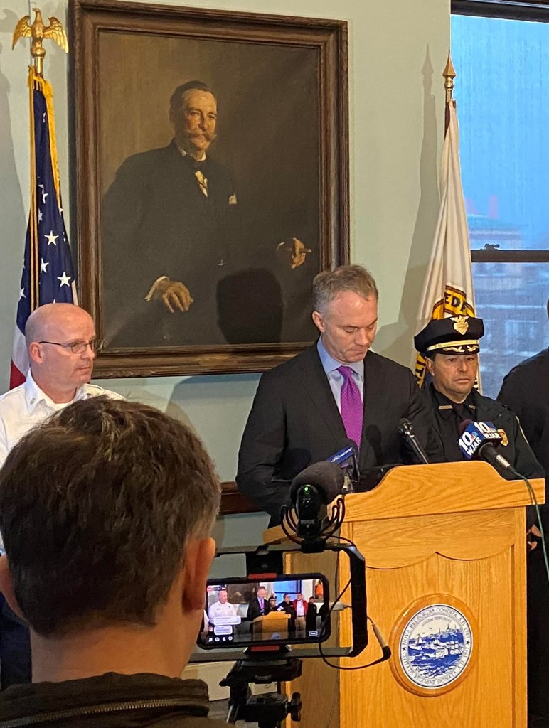 New Bedford Mayor Jon Mitchell at the podium for a press conference.