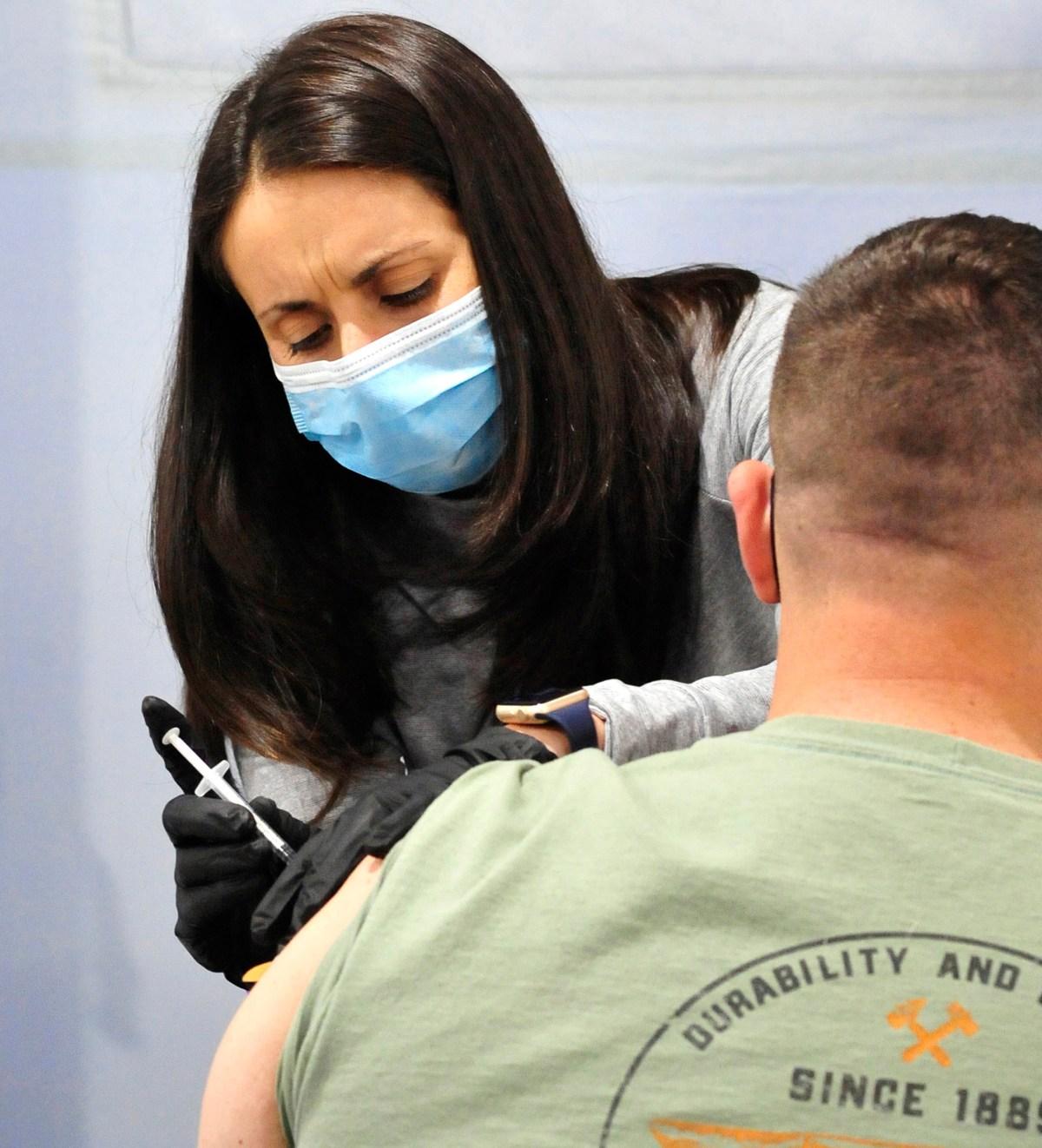 Jessica Sorelle vaccinates a patient.