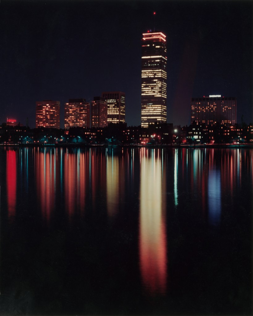 Photo of city skyline at night by William Correia.
