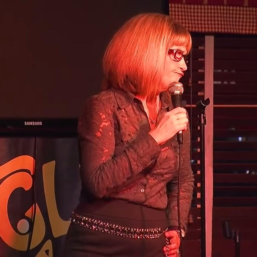 Comic Christine Hurley on stage.