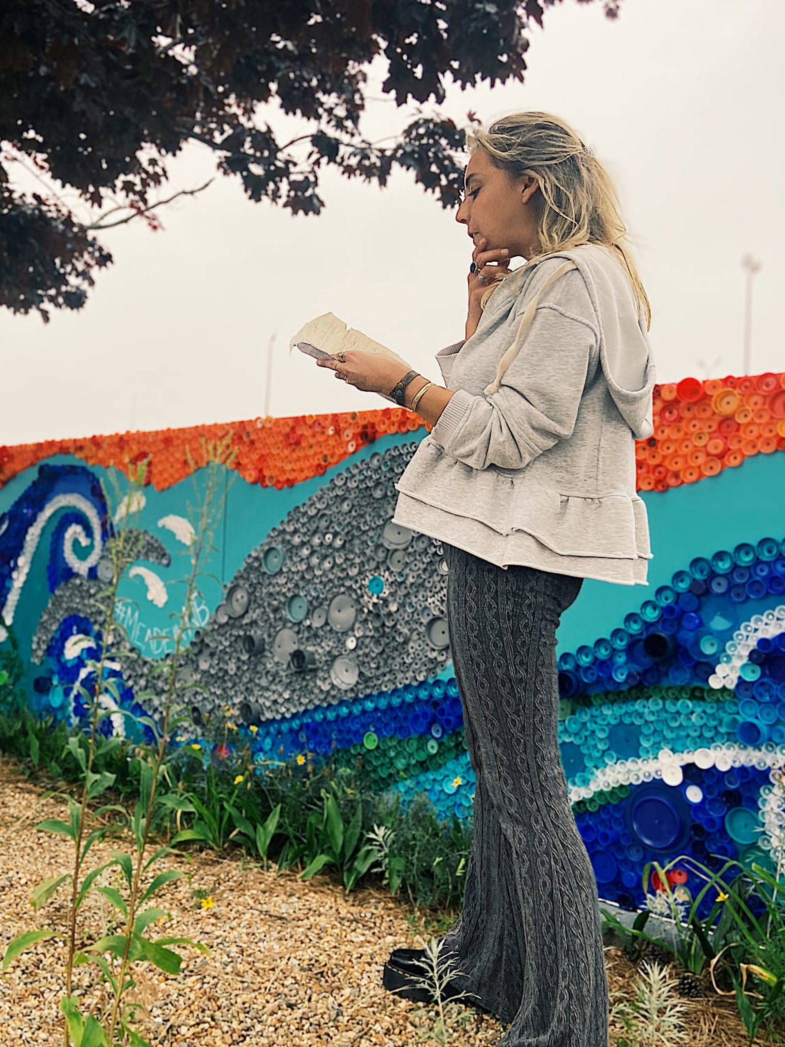 """Erin Meade with """"CAPping the Wave"""" located at the State Pier in the raised bed along the sidewalk to the right of the main car entrance."""