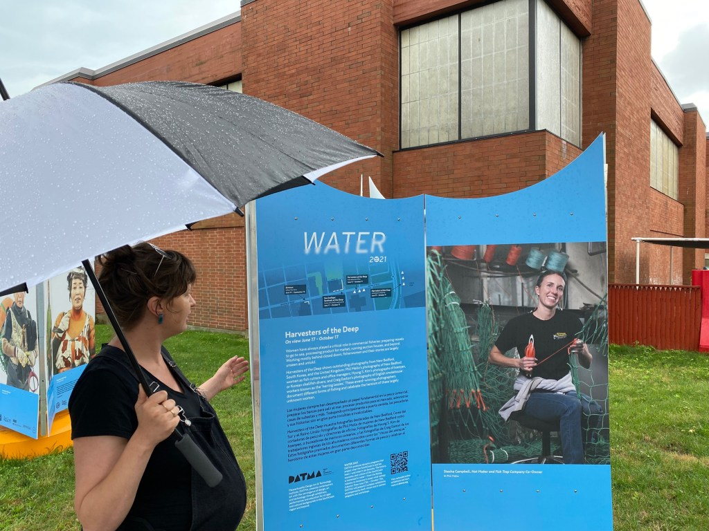 DATMA executive director Lindsay Mis by the Water 2021 display on Union Street.