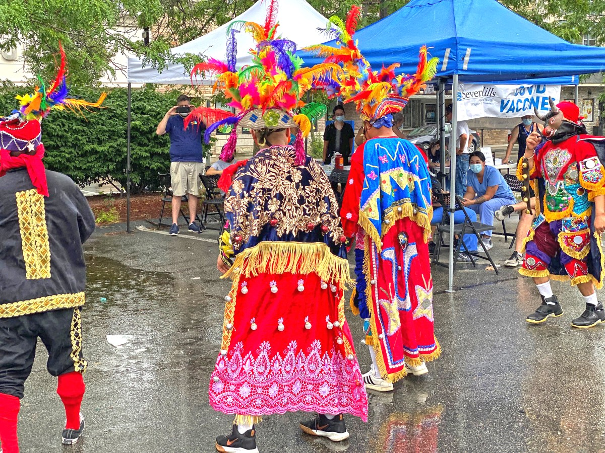 Mayan dancers perform outside a mobile vaccine clinic.