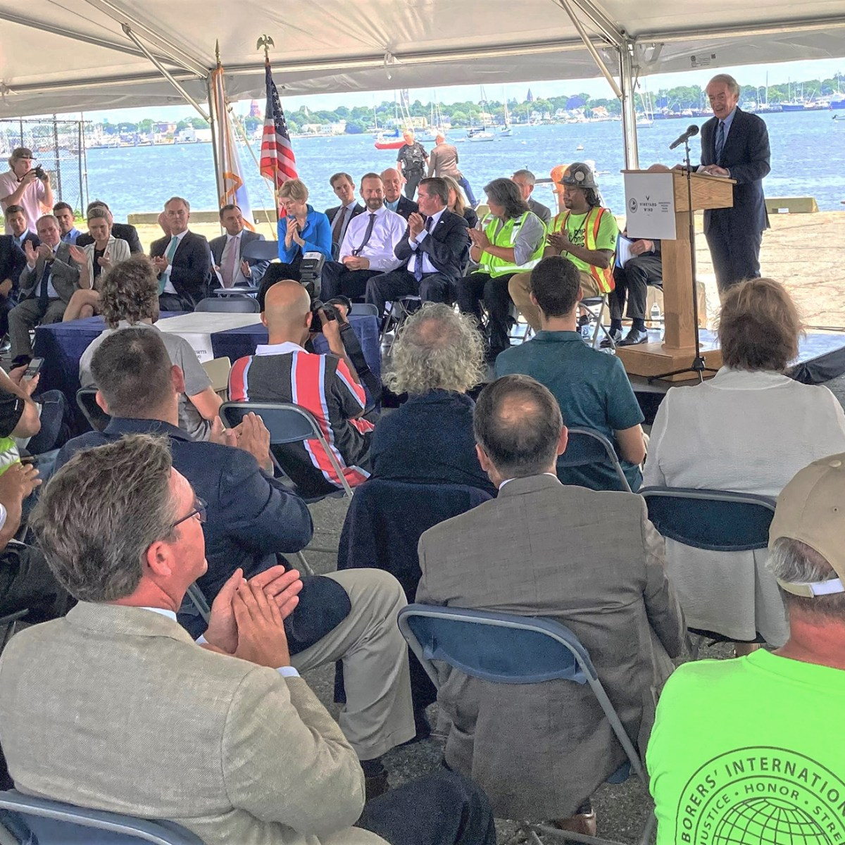 U.S. Sen. Ed Markey at podium under tent at Marine Commerce Terminal in New Bedford.