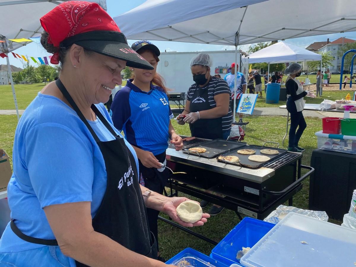 Carmen Martinez prepares pupusas while Raquel Diaz grills.