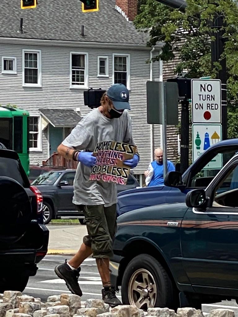 "Scottie B. walks ""the octopus"" intersection downtown."