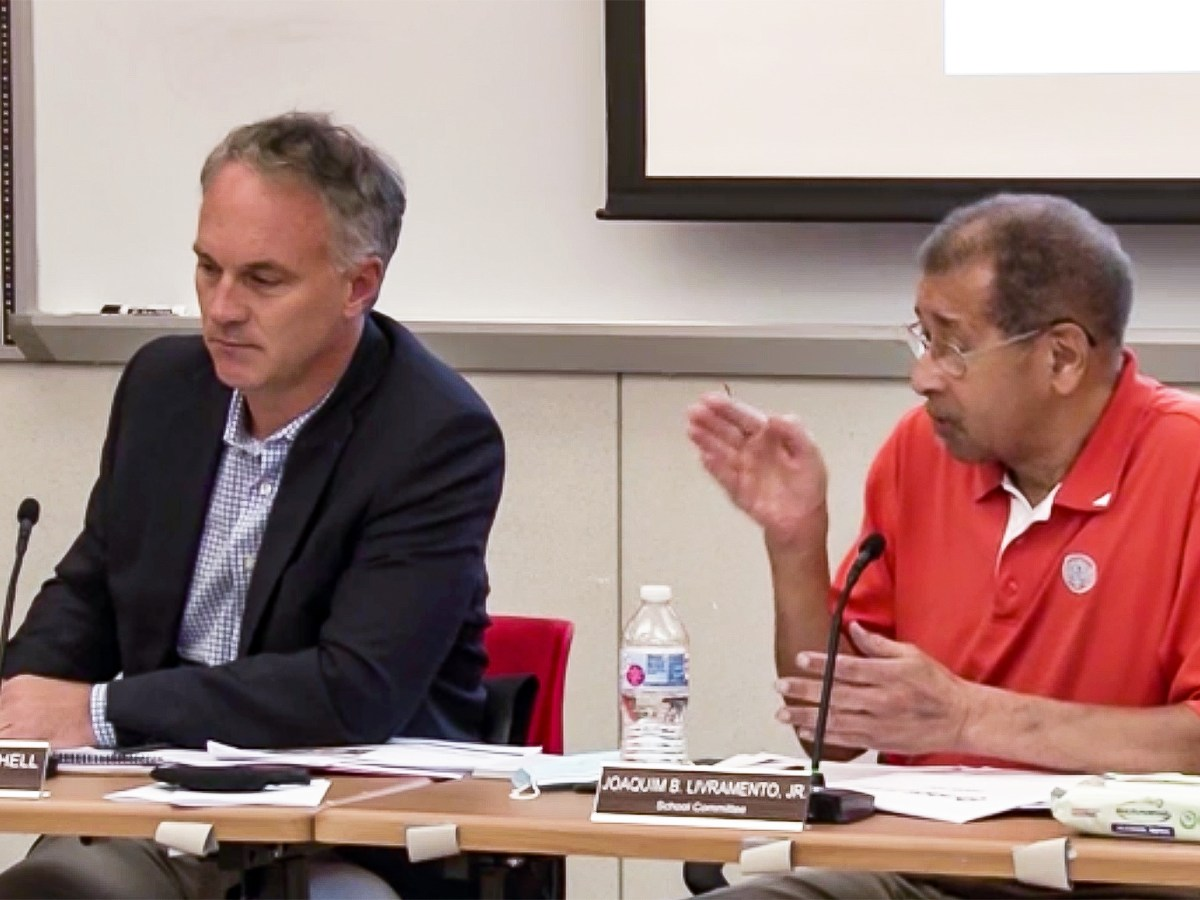 Mayor Jon Mitchell and School Committee memberJoaquim Livramento at the Aug. 9 school board meeting.